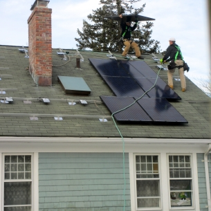 Installing solar panels on roof of house in Stamford, CT